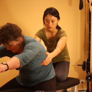 Kyung-sun-Baek-gyrotonic-exercise-training-session-back-pain-relief
